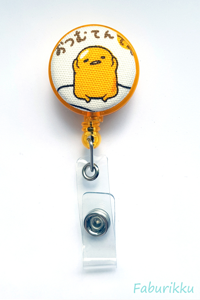 Gudetama Yellow Sit Clip-On Badge Reel