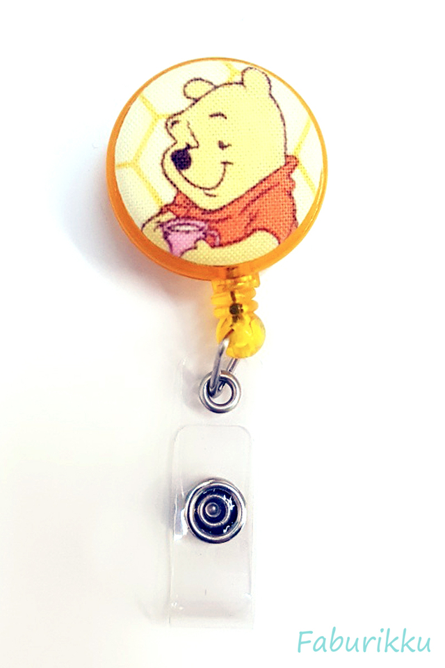 Pooh YellowTeacup Clip-On Badge Reel
