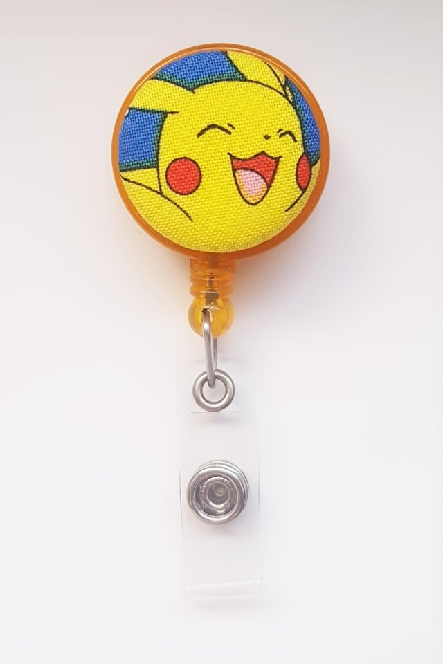 Pokemon Pikachu Yellow Happy Clip-On Badge Reel